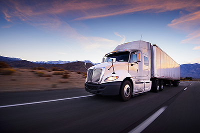 Dupre Logistics Freight Carriers Driving Down Road
